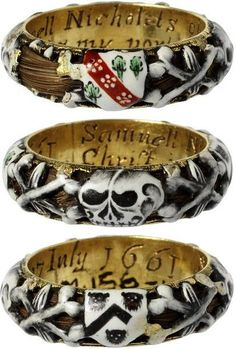 """This enamelled gold mourning ring commemorates the death of Samuel Nicholets of Hertfordshire who died on 7th July 1661, as is recorded in the inscription inside the ring. The ring is hollow, and a lock of hair curls around within it, visible through the openwork of the enamelled decoration of skulls and coats of arms."""