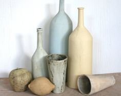 SALE. Ceramic still life in cool color palette. Bottles, fruit, blue, yellow, pastel, rustic.