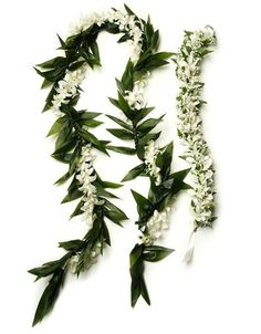 """A beautiful """"haku"""" lei for the bride, worn as a crown, and an elegant, long ti leaf lei with orchids, made to mimic the traditional maile lei for the groom."""