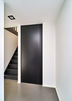 Modern black interior door from floor to ceiling by Anyway Doors.