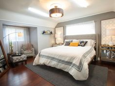 A neutral color scheme of gray and white with gold accents gives a luxurious look to this bedroom.
