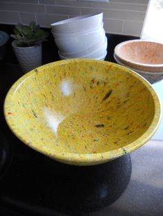 Saffron Melmac Texasware Confetti bowl. I have one in brown tones, but I would like some in colors like yellow, blue, green, and pink.