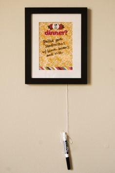 """""""Dry Erase"""" board from a framed scrapbook collage! Lots of fun DIY tutorials on this blog!"""