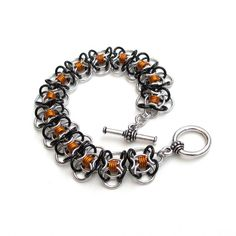 Chainmaille bracelet in orange & black by TattooedAndChained, $35.00