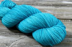 Aquamarine is a semi-solid colour that is available in the Belle, Solo, Mericana DK, and Aran bases. Yarn Colors, Colours, Hand Dyed Yarn, Eco Friendly, Hand Painted, Throw Pillows, Toss Pillows, Cushions, Decorative Pillows