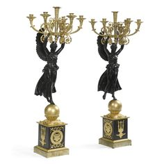 A large pair of Empire ormolu and patinated bronze six-light candelabra, attributed to Pierre-Philippe Thomire, circa 1810.