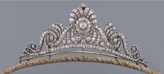 A diamond tiara 19th Century of openwork scroll design with a palmette motif to the center, set throughout with circular-cut and old-cut diamonds, detachable tiara fitting, accompanied by its fitted case.