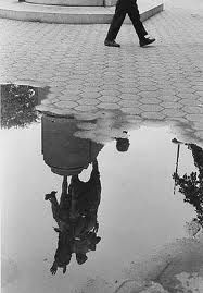 Andre Kertesz. Washington Square Park After the Rain. 1970......a shot like this, with the balloon reflected in the water