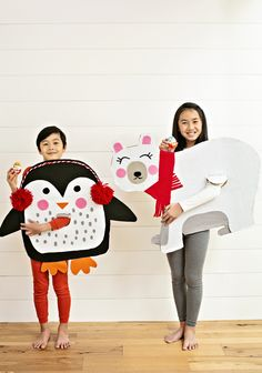 Half the fun of Halloween, other than the fun treats and spooky decorations, are the costumes! These one-dimensional costumes are easy as you just need a piece of flat cardboard! You can easily dress them with paper details like Woodland Animal Costumes or use felt for additional texture and details. These costumes definitely surprised and delighted my kids, as much as when they unwrap a delicious Kinder Joy egg. If you haven't tried Kinder Joy eggs, you're in for a treat and surprise! Diy Penguin Costume, Bear Costume, Cardboard Costume, Diy Cardboard, Handmade Halloween Costumes, Diy Costumes, Costume Ideas, Halloween Activities, Halloween Kids
