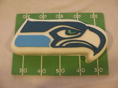 Seattle Seahawks Football Cake by frostmesweet, via Flickr