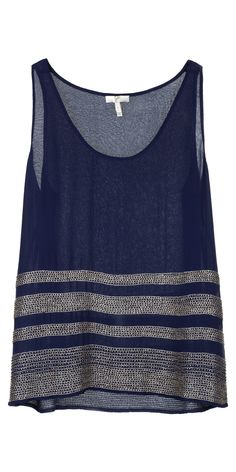 A beautiful top in delicate silk georgette features rows of striped silver beads.