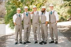 Fedoras, rolled sleeves, and no jackets on the groomsmen at a wedding