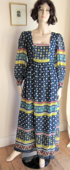 60s/70s Sherman of London blue maxi dress with daisies vintage Bust 36    Bust = 36  Waist = 40  Hips = 44  Sleeves = 24  Circumference at hem =