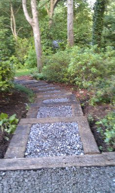 a garden path of stone & railroad ties