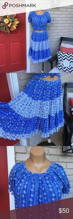 Vintage handmade blue square dance cowgirl set Two piece blue patterned set. Matching loose top and skirt. Skirt zips/buttons in back. The top is generally tucked into skirt for square dancing or can be modernized by tying up in front and pairing with cowgirl boots! Fits appx size 4/6. Vintage Dresses