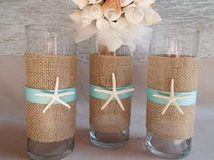 Starfish and burlap tropical beach wedding theme flower vases. Purchase through ParadiseBridal on Etsy. Your choice of ribbon color. #beachweddingcandles