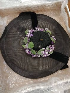 Hat size 22. This 1940s possibly 30s gorgeous vintage hat has a beautiful black velvet bow with a hook and eye closure. I measured the diameter at 18.5. It is In great vintage condition. Due to its large size it has to be shipped in a larger box as to not crush it.
