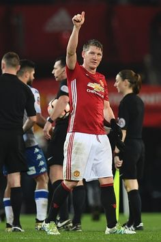 Manchester United's German midfielder Bastian Schweinsteiger salutes the crowd at the end of the English FA Cup fourth round football match between...