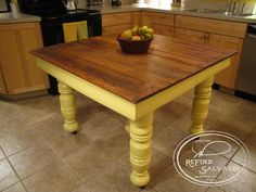 Reclaimed farm table with five legs.  Natural oak top set off by the cornbread yellow legs makes for a wonderful combination.  Signature ReFind Salvage.