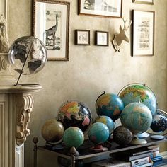 totally want to decorate w/ a globe collection.