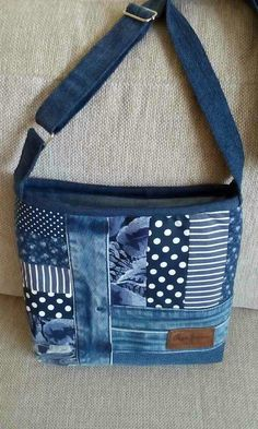 Pieced bag in blues. Some recycled jeans and some polka dots, stripes and florals. Add some hardware for a professional looking designer bag.