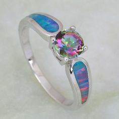 A striking mystic topaz stone serves as the focal point of this sterling silver ring while rainbow opals lend eye-catching appeal. RING DETAILS - Metal: sterling silver MYSTIC TOPAZ DETAILS - Shape: r 170204 Opal Jewelry, Sterling Silver Jewelry, Fine Jewelry, Silver Ring, Gold Jewellery, Silver Bracelets, 925 Silver, Silver Earrings, Do It Yourself Fashion