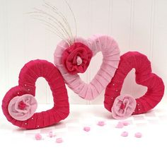 Add some festive Valentine's decor to your home or classroom with these felt wrapped styrofoam hearts.