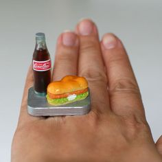 A Super Cute Chicken Cheese Sandwich with a bottle of Cola!!! Perfect Lunch Combo!!    It measures approx. 1.35 inch wide and 1.65 inch high is on a silver plated adjustable bang that will fit most ring sizes.