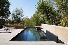 Limestone coping and pavers lend a rugged look to the second level's pool.
