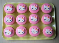 the girl in the green dress.: hello kitty cupcakes.