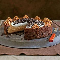 Cinderella Cheesecake | A chewy ring of brownie-batter crust folds over creamy and luscious peanut butter cheesecake. Yes, please! | SouthernLiving.com