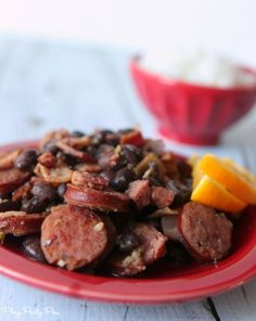 Bacon, sausage, black beans, and rice make this Brazilian feijoada the perfect comfort food, recipe from playpartypin.com