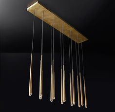 """RH Modern's Aquitaine Linear Chandelier 60"""":Inspired by French minimalist lighting of the 1960s, Jonathan Browning's elegant design features a cluster of solid brass forms suspended from slender black cords. Inset LED bulbs at the tips offer warm, glowing light."""