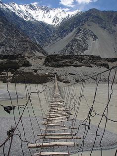 One of the most dangerous bridges in the world, Hussaini Hanging Bridge in Northern Pakistan NO WAY! seriously, build a better bridge or decide there is nothing on the other side worth it! Places To Travel, Places To See, Beautiful World, Beautiful Places, Scary Bridges, Dangerous Roads, Covered Bridges, Far Away, Wonders Of The World