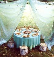 combining hanging fabric with table AND stumps...wow.  We could improve upon this, though.
