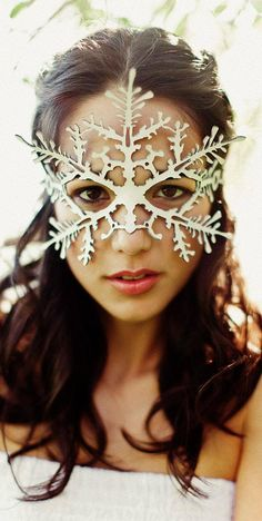 A very delicate cut out mask of a snowflake. Made of lightweight vegetable tanned leather, wet formed and painted either metallic silver, white, or white pearlescent. Weighing in at 1/5 of an ounce (6 gm), this lovely mask can be worn all day in comfort. Comes with an adjustable double
