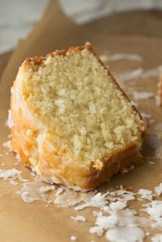 Coconut Pound Cake - Moist, rich pound cake made with shredded coconut and drizzled with coconut glaze #desserts #coconut