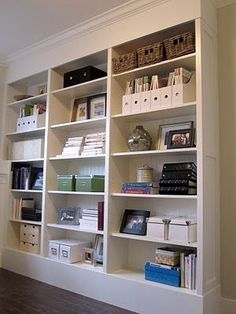 #ikea BILLY bookcases: hacked to look like built-ins (backing replaced with bedboard, crown added, base built up, end panel added to one side etc.)