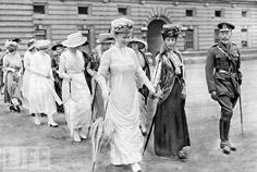Her Majesty Queen Mary Queen Alexandra His Majesty King George V walking with rest of the Royal party across lawn of Buckingham Palace to view the.