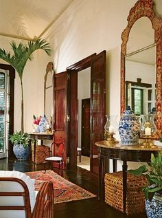 Ralph & Ricky Lauren : In their idyllic home on Jamaica, the couple fashion a singular island elegance. Asian accents, such as antique ginger jars and chinoiserie mirrors, contribute to the living room's exotic feel. Love the richness of this room