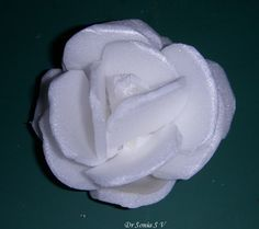 Rose made from pieces of packing styrofoam.  Great idea.. then just cover with gesso and paint!