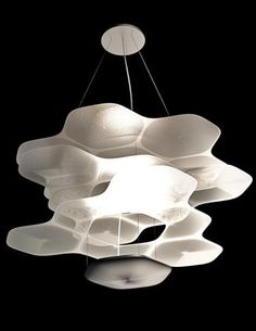 Artemide's Space Cloud fixture by Ross Lovegrove is an LED suspension lamp made of four layers of anodized aluminum that reflect the light e...