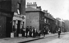 """John Galt, a London City Missionary, took this photo of the mission hall in Grundy Street, Poplar, around 1900-1907. It was one of many small houses set up in poor areas by the London City Mission to offer inter-denominational evangelism, free children education through so-called """"Ragged Schools"""" and help to the needy. A poster advertises a gospel service to be held that evening."""