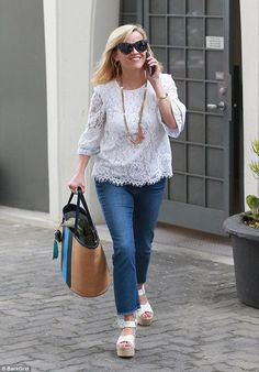 Smiling ear to ear: Reese Witherspoon was photographed chatting on her phone and wearing a...