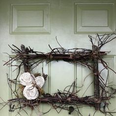 glue or tie branches and other small decorations to frames as a twist on the door wreath