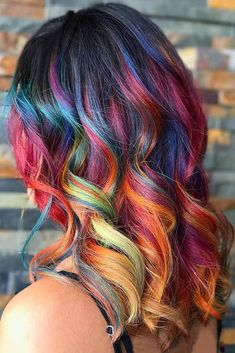 Try rainbow hair that is rich, dark, fantastic and mysterious. The new oil slick hair trend allows brunettes to get awesome look without any harsh bleaching. #haircolor #brunette #rainbowhair