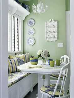 Cheerful but calm colors. The shelf over the window is great- I do that all the time- always need extra display space!