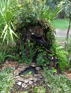 A fairy garden inspired by others seen on Pinterest – it's hard to see, but there is a small waterfall spilling into the little pond