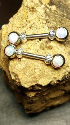 For nipples- Opal Nipple Bars https://www.etsy.com/ca/listing/248949689/forward-face-white-opal-nipple-ring