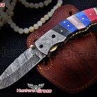 damascus custom hand made folding knife,liner lock ,stained camel bone